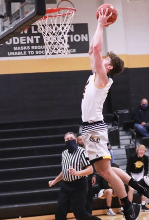 New London's Kade Benjamin goes in for the dunk in the Tigers' win over Holy Trinity Tuesday night at Charles Lorber Gymnasium in New London.