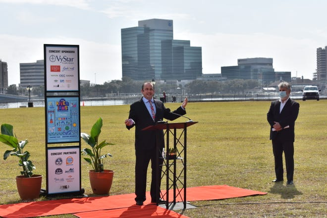 Jake Gordon, CEO of Downtown Vision, announces a new free concert series planned for Riverfront Plaza, former site of The Jacksonville Landing.