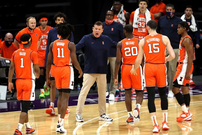 Illinois coach Brad Underwood talks with his players in the first half against Northwestern on Jan. 7, 2021, at Welsh-Ryan Arena in Evanston, Ill.