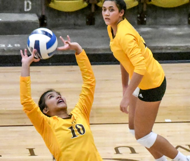 Garden City Community College's Remi Vargas, left, sets the ball for teammate Pulelehua Keb to make a kill during a match earlier this season at Perryman Athletic Complex. Vargas has been named the Jayhawk Conference's setter of the week.