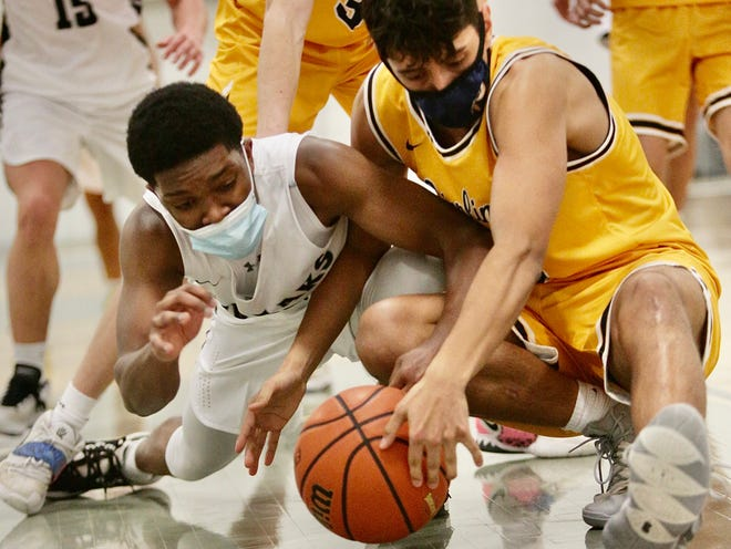 Galesburg High School senior Demarco Harden, left, battles a Sterling High School defender for a loose ball during the Silver Streaks' 50-47 season-opening win over the Golden Warriors on Tuesday, Feb. 9, at the GHS field house.
