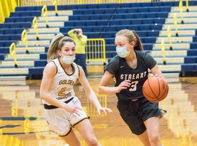 Galesburg's Riley Jenkins drives past Sterling's Breelyn Borum during the first quarter of Tuesday's game at Sterling.