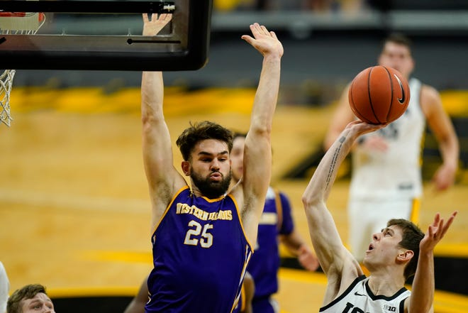 Iowa forward Patrick McCaffery, right, shoots over Western Illinois forward Will Carius, left, during the second half of a game on Thursday, Dec. 3, 2020, in Iowa City, Iowa.