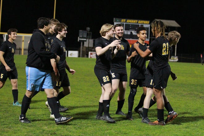 The Gators celebrate their return to the state quarterfinals following their 3-2 victory over Brother Martin on Tuesday night.