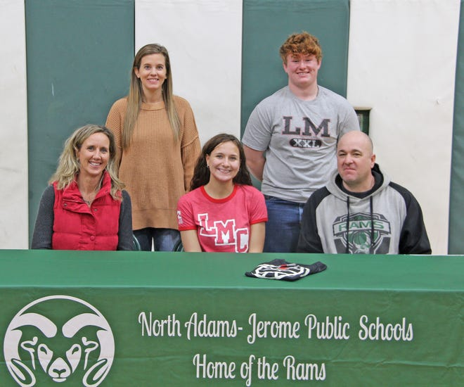 North Adams-Jerome senior Abi Nunez (center) recently signed her letter of intent to play volleyball at Lake Michigan College. Pictured with Abi are her parents Mike Nunez (far right, front), Karla Nunez (far left, front), North Adams head coach Amy Case (back row left) and Caleb Brink (back row, right).