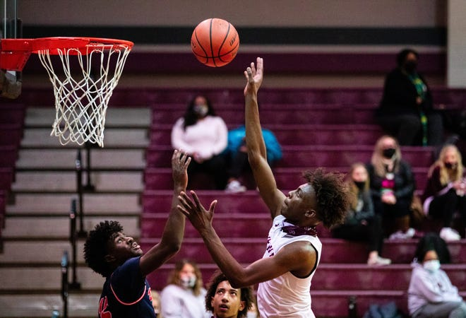Sherman's Jalarien Wilson puts up a shot during the Bearcats' loss against McKinney North in the District 10-5A finale.