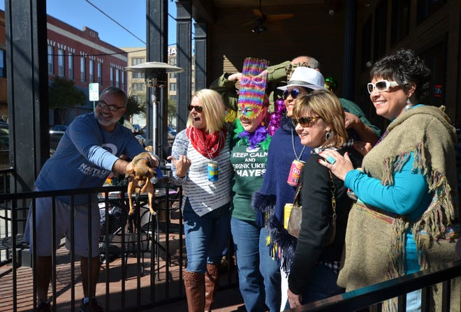 Crowds of revelers gather outside Old Iron Post in downtown Sherman for Mardi Gras in this file photo from 2017. Organizers plan to move forward with the annual event this weekend in spite of expected freezing temperatures.