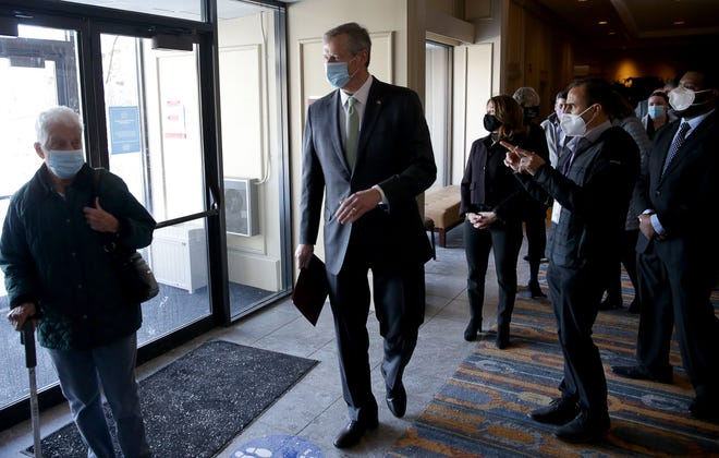 Gov. Charlie Baker toured the mass vaccination site at DoubleTree by Hilton Hotel in Danvers on Wednesday, Feb. 10. [Jonathan Wiggs/Boston Globe/Pool]