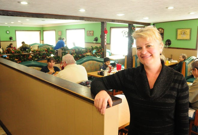 Marlena Pavlos-Hackney poses for a photo in Marlena's Bistro and Pizzeria — formerly known as The Salad Bowl — in 2014. Pavlos-Hackney kept her restaurant open despite a statewide dine-in ban lasting two and a half months from November 2020 to February 2021.