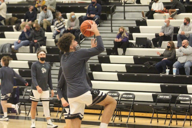 The West Ottawa boys basketball team opened their season with a win over Hudsonville on Tuesday, Feb 9.
