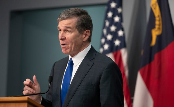 Gov. Roy Cooper speaks during a press briefing on the COVID-19 virus and vaccination efforts on Feb. 9 at the Emergency Operations Center in Raleigh. People who are unemployed in North Carolina will be required to prove they're searching for work in order to keep their jobless benefits.