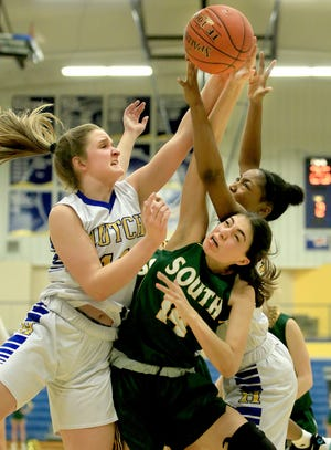 Hutchinson's Mya Thompson (11) and Ziya Simms (10) battle for the rebound with Salina South's Elizabeth Franco (14) during their game Tuesday night at the Salthawk Activity Center. Hutchinson defeated Salina South 42-32. To see a gallery of photos from both games, go to www.hutchnews.com/sports