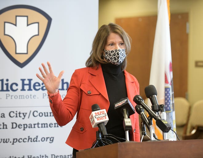 Rep. Cheri Bustos speaks during a press conference at Peoria City/County's vaccination site in Heddington Oaks Wednesday morning.