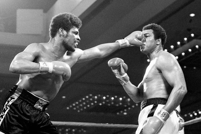 In this Feb. 15, 1978, file photo, the fist of challenger Leon Spinks flattens the nose of heavyweight champion Muhammad Ali during their title fight at Las Vegas. Former heavyweight champion Leon Spinks Jr. died Friday night after battling prostate and other cancers. He was 67.