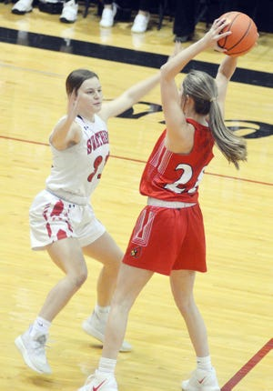 Hesston sophomore Anna Humphreys guards a Hoisington player during a CKL game Tuesday in Hesston.