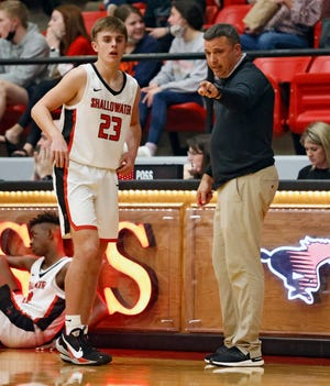 Shallowater coach Jay Lusk talks to Trevor Winn (23) during a District 2-3A game Feb. 9 against Abernathy in Shallowater.