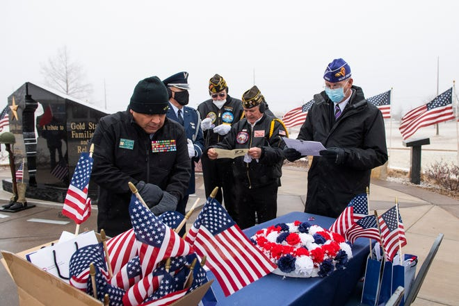 Members from the Lubbock VFW Post 2466 prepare for a ceremony honoring Medal of Honor recipient Lieutenant Colonel George Davis at Lubbock's Monument of Courage on Wednesday, Feb. 10, 2021, in Lubbock, Texas.
