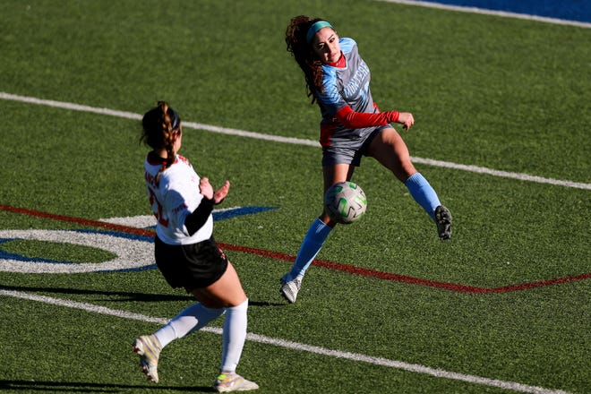 Monterey's Daniela Pena (10) clears the ball against Coronado on Feb. 9 at Lowrey Field at PlainsCapital Park in Lubbock.