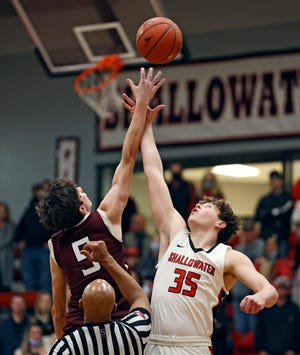 Abernathy's Luke Houston (5) and Shallowater's Kieran Elliott (35) tip off the ball during the game, Tuesday, Feb. 9, 2021, in Shallowater, Texas.