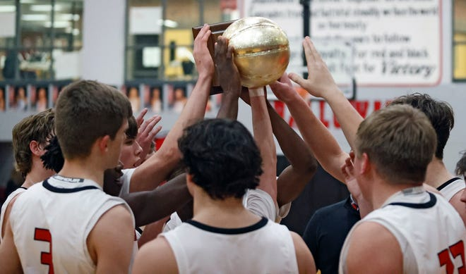 Shallowater players celebrate with the District 2-3A trophy after the game against Abernathy on Tuesday in Shallowater.