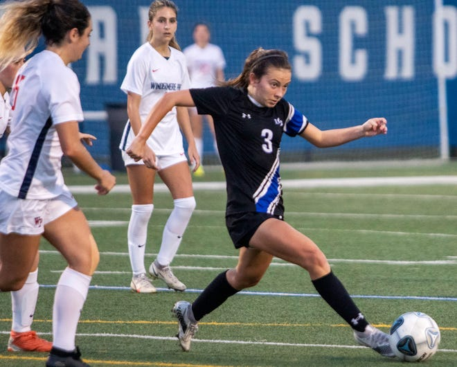 Lakeland Christian senior Katie Carnes gets around Windermere Prep defenders on Tuesday night in the Class 3A, District 6 girls soccer championship match at Viking Stadium.
