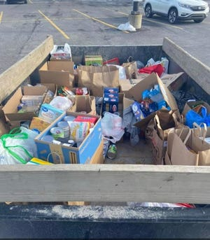 Pictured is just a small portion of the food collected by Carlie and Claire DelSignore for their senior project.