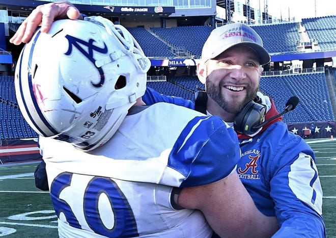 Ashland head coach Andrew MacKay hugs graduated senior Ryan Dwinnells (left) as time expires in the Clockers' victory over Bishop Fenwick in the Div. 6 Super Bowl on Dec. 7, 2019 at Gillette Stadium. MacKay was recently named as the Section 1 Football Coach of the Year by the National Federation of High School Sports (NFHS).