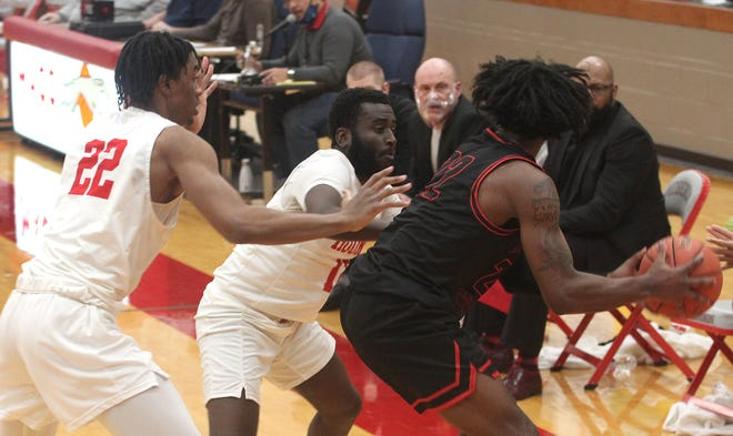 Moberly Area Community College's Makalani Kafele (#22) and Tyen Moore trap Atavian Butler of North Central Missouri College in Trenton (with ball) while the Greyhounds apply a full court press Tuesday. MACC men needed overtime to grind out a 110-109 home triumph against the Pirates.