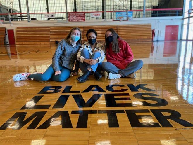 Black Lives Matter logo on  High School gym floor ignites discussion