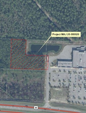 This 2.15-acre tract near U.S. Highway 98 adjacent to the Publix grocery in Santa Rosa Beach will be the site of an 18,000-square-foot Ace Home Helpers hardware store and another 9,000-square-foot building. Walton County commissioners on Tuesday approved a final development order for the project.