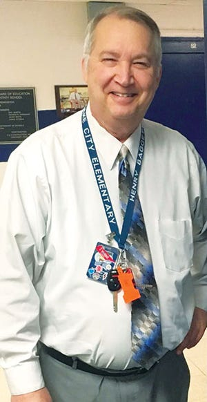 Lake City Elementary School in the Anderson County school system was closed Wednesday after the unexpected death of the school's longtime principal Henry Baggett.