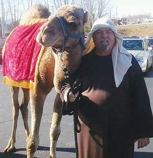 This photo shows James Cox and one of the Zoo's camels, perhaps Carl, who has also passed away. James would often bring his animals to area nativities during the Christmas season.