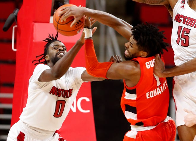 North Carolina State's D.J. Funderburk fights for the rebound with Syracuse's Quincy Guerrier (1) during the second half Tuesday in Raleigh, N.C.