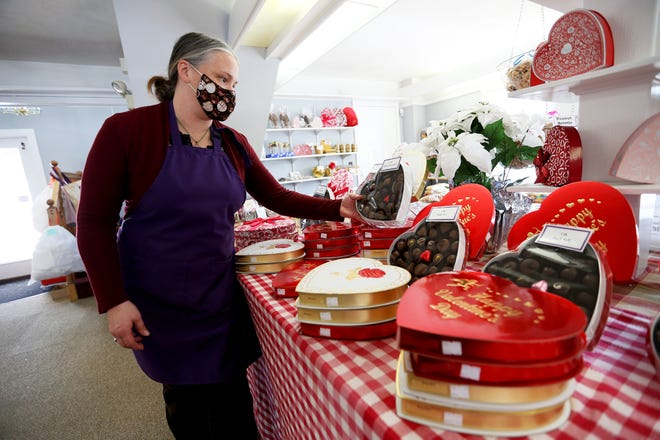 Caren MacAskill, owner of Huckleberry Candies, is getting ready for Valentine's Day in Hampton on Wednesday afternoon.