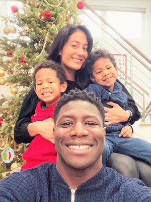 Former University of New Hampshire football standout Jerry Azumah, front,with his fiancee, Bianca Camerena and their two sons, Santiago, left, and Valentino, right this past Christmas. Azumah is still living in Chicago almost 15 years after retiring from the NFL and a seven-year career with the Chicago Bears.