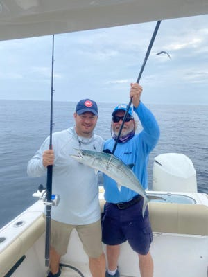 Andy Molbert (left) of Delray Beach caught this beautiful Cero mackerel on a drifted sardine while fishing with his father Lauris and Capt. Bruce Cyr (right) aboard their boat Big Swede.