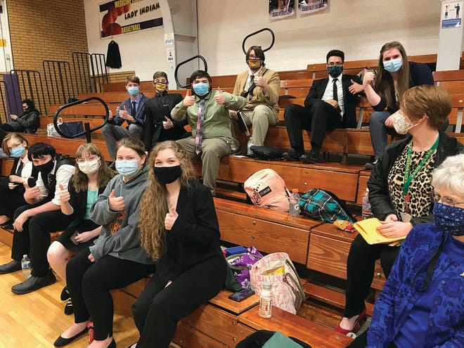 Pratt High School forensics students share thumbs-up signals at the Medicine Lodge tournament on February 4 where they earned top awards, qualifying several events for state competition.