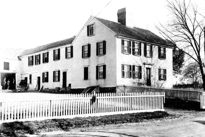 """An undated photo of the Golden Ball Inn in Pawtuxet Village. Once a year, Black families from around the state would gather outside the inn for a festive celebration that included """"electing"""" their own governor. (Courtesy Henry Brown)"""