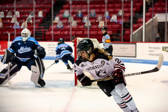 Northeastern's Skylar Fontaine on the ice in a game against the University of Maine.