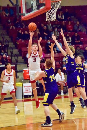 Ballinger's Ian Gressett nails a short jump shot over a Merkel Badgers player who got caught flatfooted by the quick pull up.