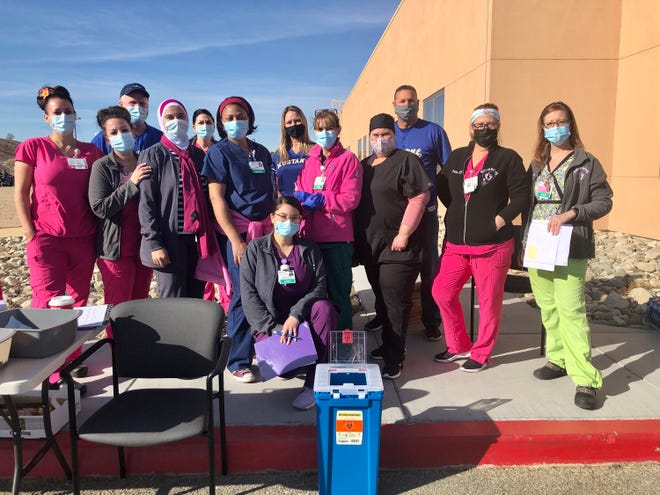 Barstow Community Hospital health care workers pose with Lucerne Valley Unified School District officials on Monday, Feb. 8, 2021, during a vaccination event at the hospital.