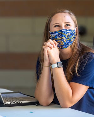 A Kent State University student wears a face covering during the COVID-19 pandemic.