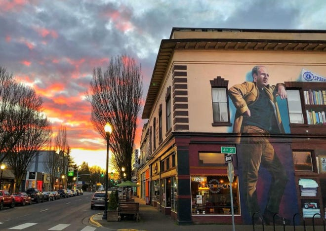 Ken Kesey stands tall on a mural at the corner of Fourth and Main streets in Springfield.