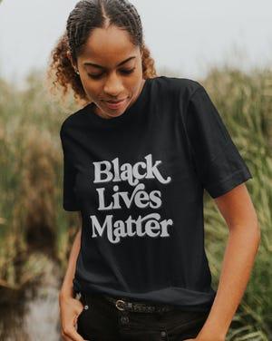 Model wears Black Lives Matter shirt available at Destinee Stark Shop