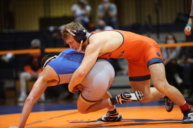 Vic Marcelli (right), a Jackson High School graduate, is off to a strong start to the 2020-21 season for the University of Virginia wrestling team.
