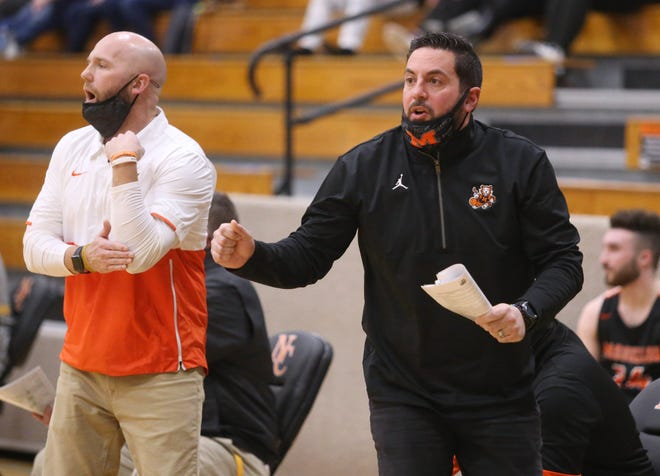 Andy Cocklin, Massillon assistant basketball coach, gives instruction from the bench during their game at Hoover on Tuesday, Feb. 9, 2021. At left is head coach Josh Hose.