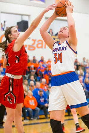 Eastland senior center Karlie Krogman, shown last year playing against Amboy, leads the No. 2-ranked Cougars against unanimous No. 1 Amboy in two games this week, on Tuesday and Thursday.
