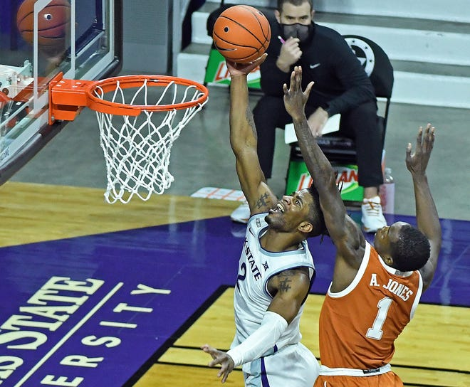 Kansas State's Selton Miguel goes to the basket against Texas guard Andrew Jones during Tuesday night's game at Bramlage Coliseum.