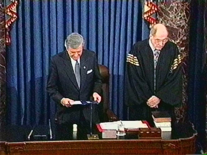 Senate chaplain Rev. Lloyd Ogilvie reads the final prayer of the impeachment trial, offering thanks for the tenor of the debate, and asking for healing for President Clinton and his family on the Senate floor Feb. 12, 1999, in Washington. At right is then-Chief Justice William H. Rehnquist.