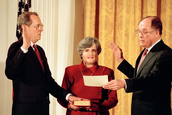 Anthony M. Kennedy, left, takes the constitutional oath as a Supreme Court Associate Justice from Chief Justice William Rehnquist at a White House ceremony Feb. 18, 1988, in Washington, D.C.  Holding the Bible is Kennedy's wife, Mary Kenndy.